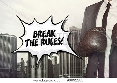 Break the rules text with businessman wearing boxing gloves