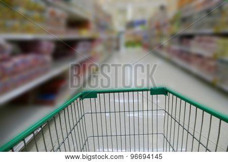cart in aisale in supermarket