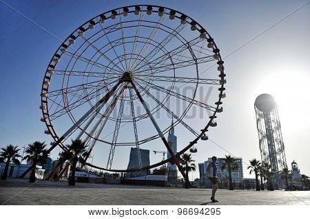 Light House And Panoramic Wheel In Batumi