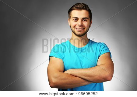 Handsome man on gray background