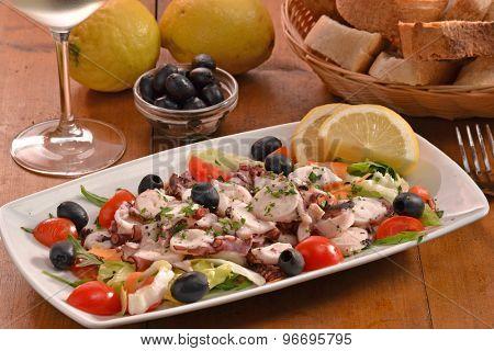 Sea salad dish served on rustic wood table.