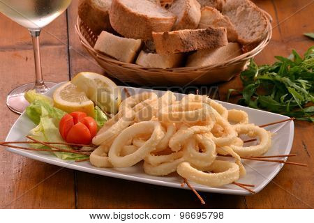 Fried squid rings salad.