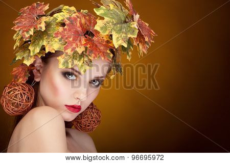 Woman With Leafs On Head In Autumn Concept
