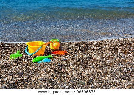 Beach toys near sea