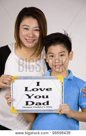 Asian Mother And Son With Blank White Board And Looking Camera