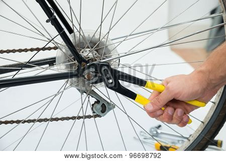Person Hands Fixing Bicycle Wheel