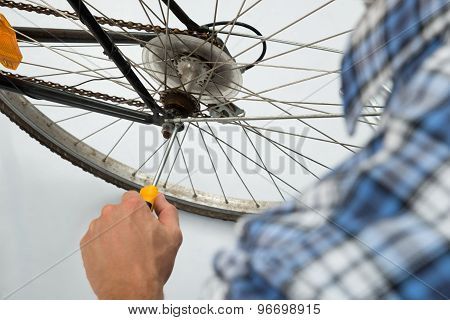 Person Repairing Bicycle Wheel
