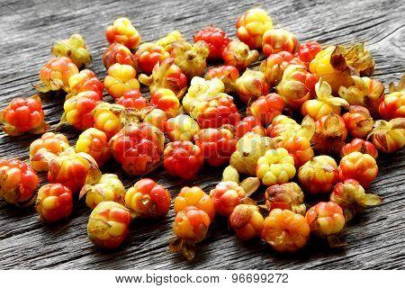 Fresh Cloudberries On Vintage Table