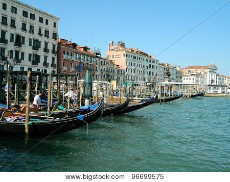 Gondolas awaiting clients in port, Venice.