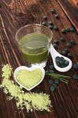 stock photo of chlorella  - Spirulina chlorella barley and wheatgrass - JPG