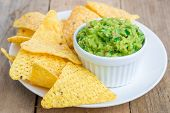 picture of nachos  - Cup with chunky guacamole served with nachos - JPG