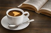 picture of continent  - Still life photography of hot coffee beverage with map of South America continent - JPG