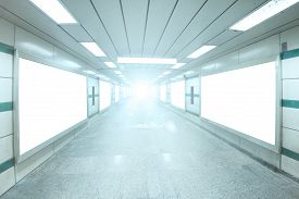 picture of underpass  - Bright underpass with blank billboard advertising wall for background - JPG