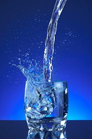pic of blue  - Water poured into a glass - JPG