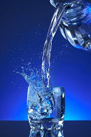 picture of liquid  - Water poured into a glass - JPG