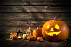 image of scary haunted  - Halloween pumpkin head jack lantern on wooden background - JPG