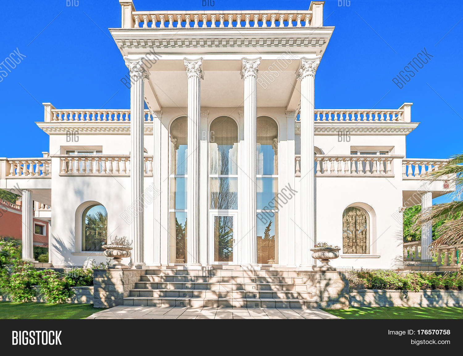 Classic Luxury House the facade of a luxurious residence with columns in the corinthian