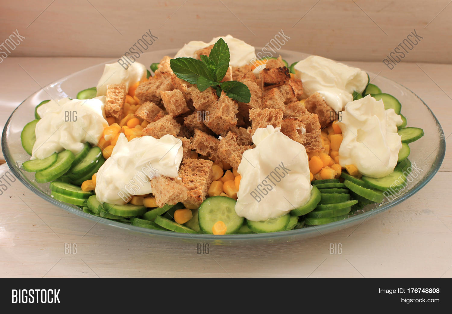 """Salad with vegetables, herbs, corn, bread crustons and ..."