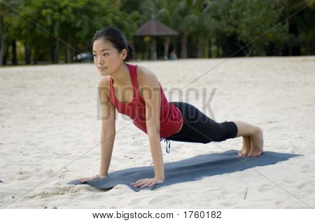 Plank Pose On Beach