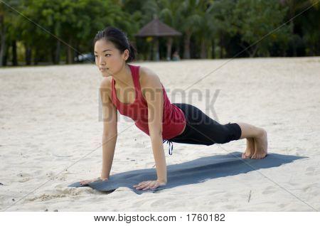 Plank Pose On Beach