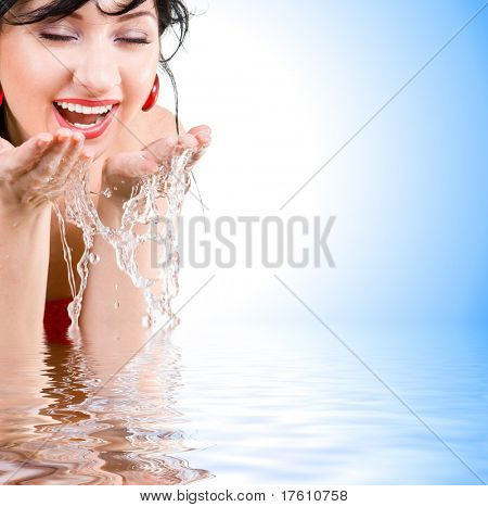 pretty woman refreshing the face isolated over white background