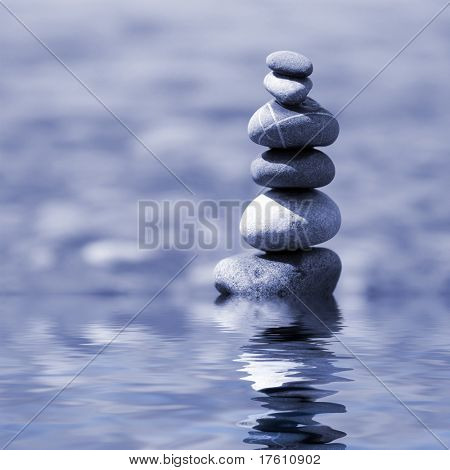 balanced stones on the water