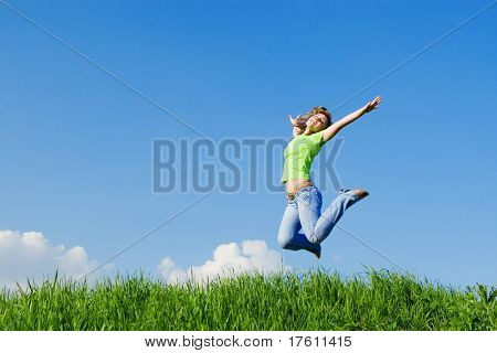 pretty young woman is jumping