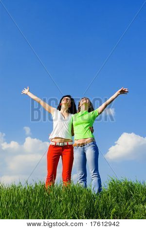two happy young women dreams to fly on winds