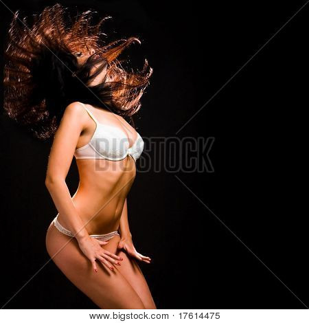 sexy woman in lingerie dancing on the black background