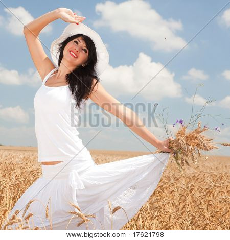 ?ute woman in golden wheat
