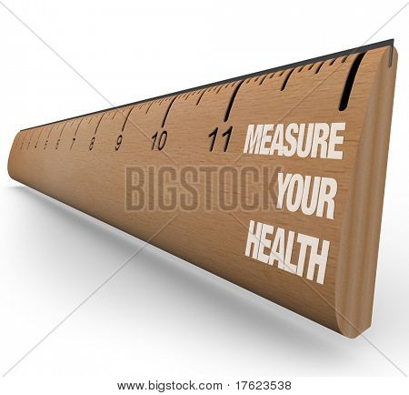 A wooden ruler with the words Measure Your Health, symbolizing the benefits of understanding your nutritional, dietary, exercise and overall health care goals and progress