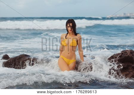 poster of Pretty Girl In Sexi Yellow Swimsuit Standing In White Foam