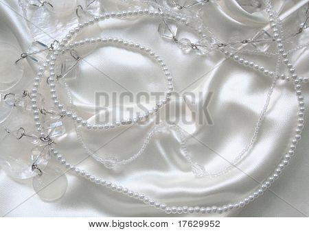 White Pearls And Nacreous Beeds On White Silk