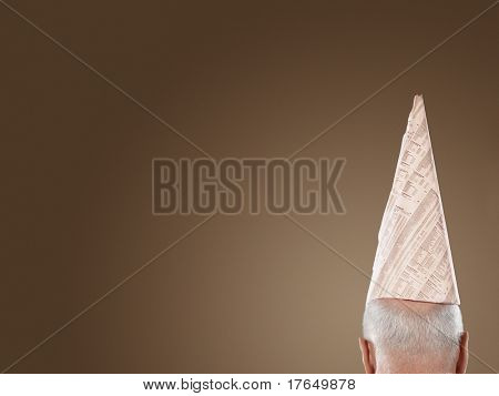 Man Wearing Dunce Hat, high section, back view