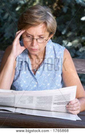 Middleaged Woman Reading Newspaper