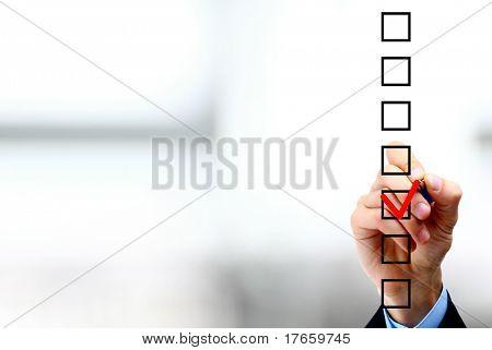 Hand choosing one of three options