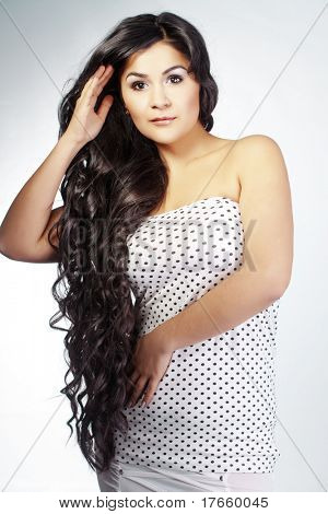 Portrait of young beautiful woman with extra long glossy hair