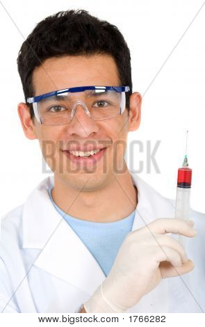 Male Doctor With A Syringe