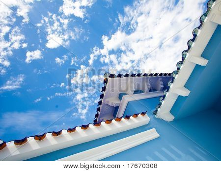 blue house against blue sky