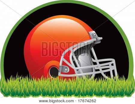 football helmet on grass with black background