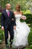 picture of wedding couple  - Beautiful young couple walking together about to get married - JPG