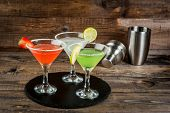 Постер, плакат: Three Types Of Alcoholic Cocktails With Martini