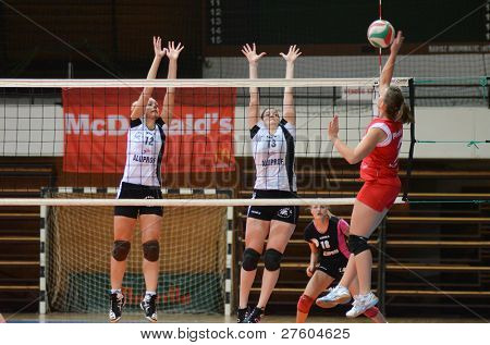 KAPOSVAR, HUNGARY - NOVEMBER 25: Zsanett Pinter (R) in action at the Hungarian Championship volleyball game Kaposvar (red) vs TFSE (white), November 25, 2011 in Kaposvar, Hungary