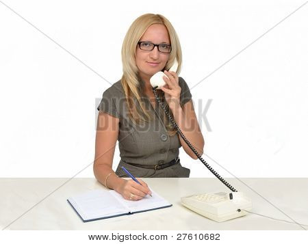 Business woman working in office talking by phone