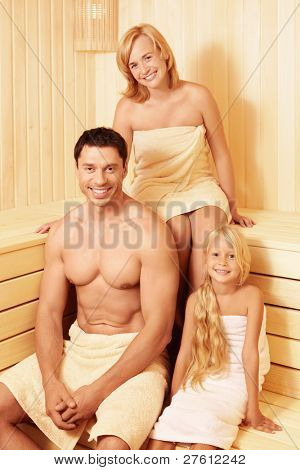 Young family in the sauna