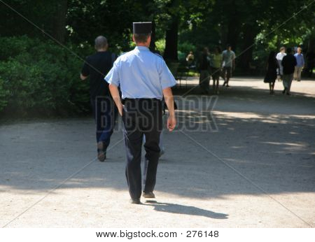French Gendarme In Paris Park
