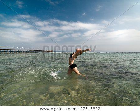 Woman enjoying sea and sun
