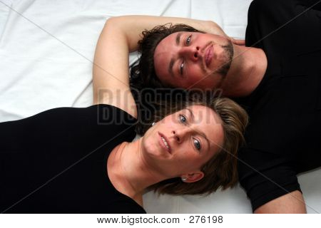 Couple Laying On White