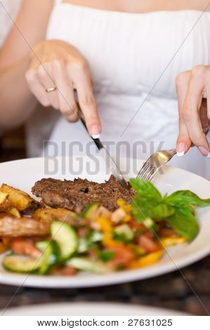 Woman Eating In Restaurant