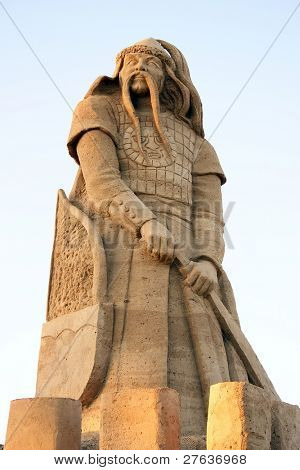 Warrior with his sword and shell from sand